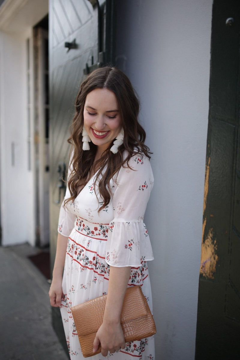New Orleans fashion in the French Quarter. Blogger styles an Endless Rose red and white maxi dress with white misa tassel earrings.
