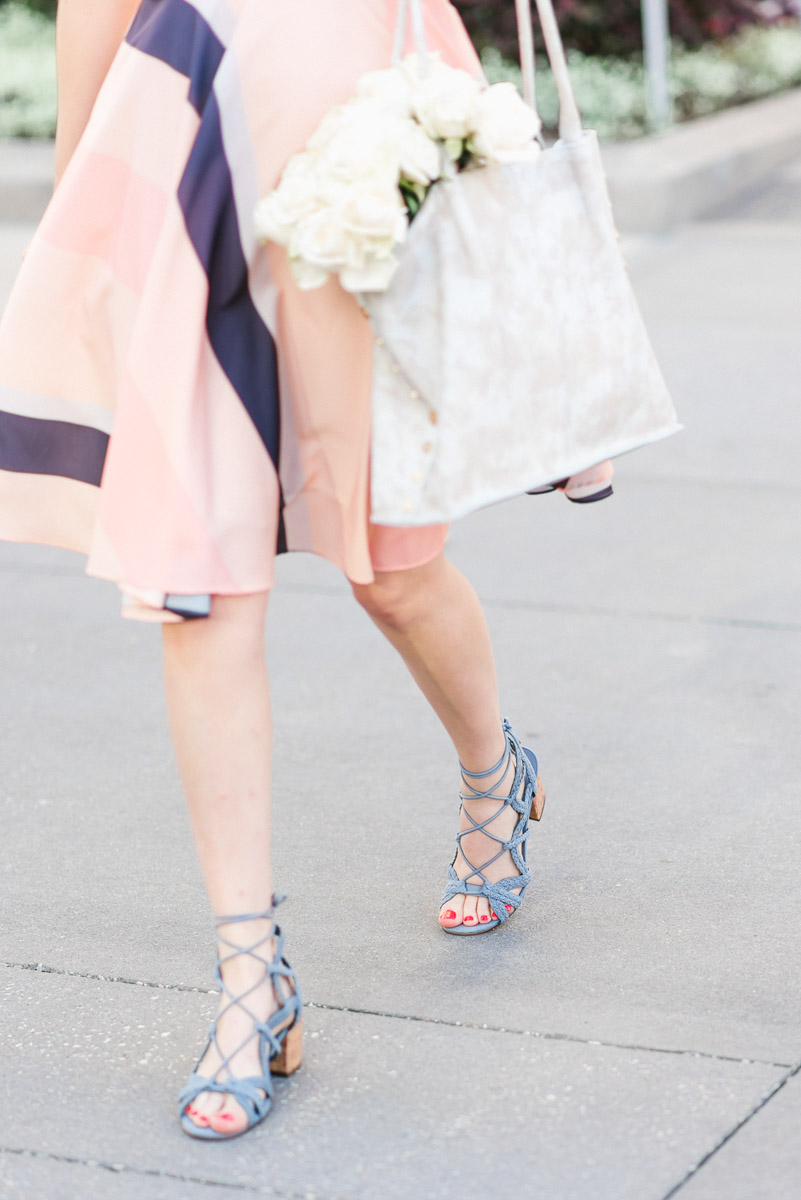Houston blogger styles a striped papercrown dress with blue Indigo rd. heels.