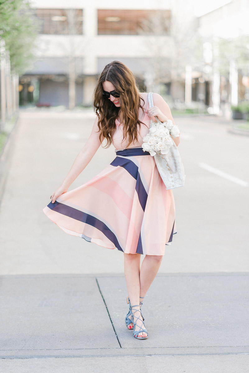 Houston fashion blogger styles a Papercrown pink striped dress with a white Hammit tote bag.x