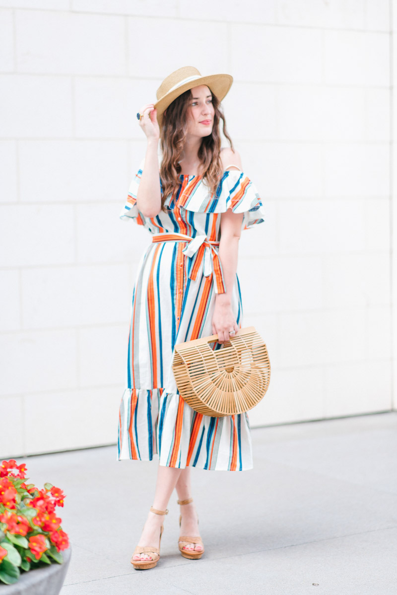 Houston blogger styles a striped moon river off the shoulder dress with a boater hat and Cult Gaia bag.