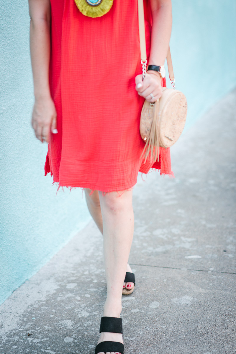 Red off the shoulder dress styled with black wedges from Sole Society.