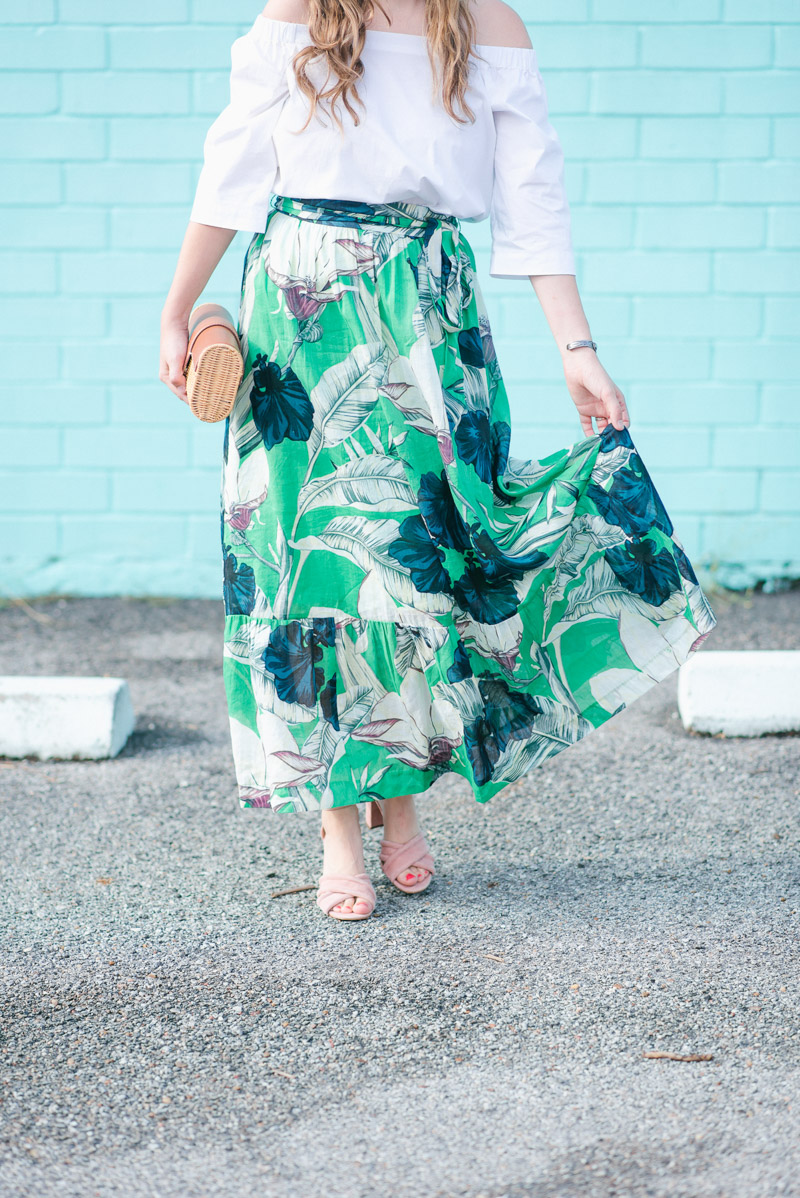 Ann Taylor green floral maxi skirt styled with pink velvet heels.