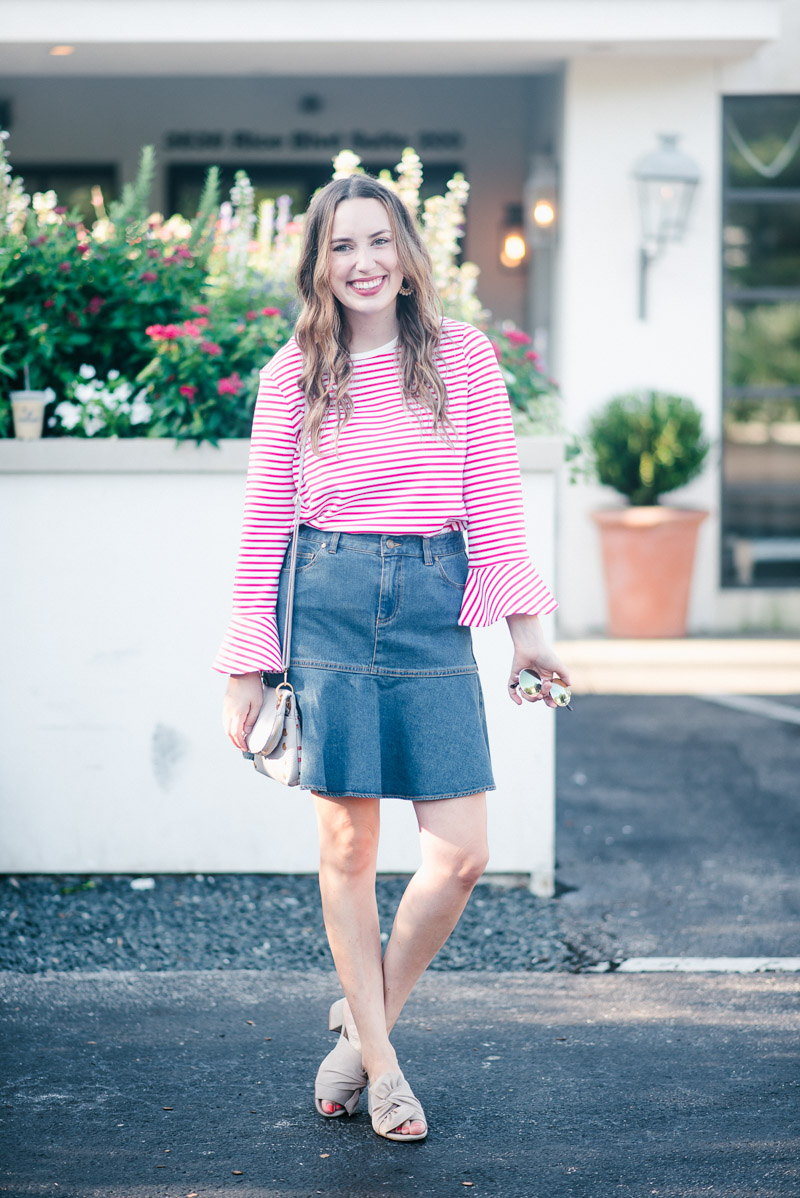 Texas blogger styles a Draper James denim skirt with a red striped bell sleeve top.