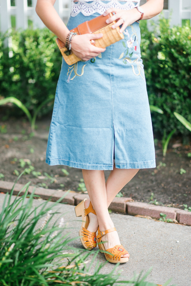 An embroidered denim midi skirt paired with Swedish Hasbeens sandals.