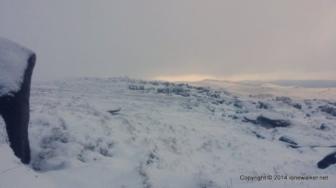 The path around the edge of Kinder is non-existent under the snow and we make progress as best we can - the deeper peaty bogs are disguised by snow, and we fall foul of a couple