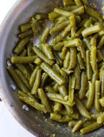 Canned green beans from the best canned green bean recipe in a skillet.