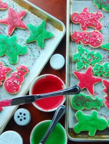 Far off view of iced sugar cookies on a sheet tray.