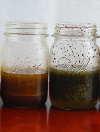 Homemade salad dressing in 4 jars in a row.