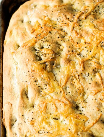 Baked homemade focaccia recipe in the pan.