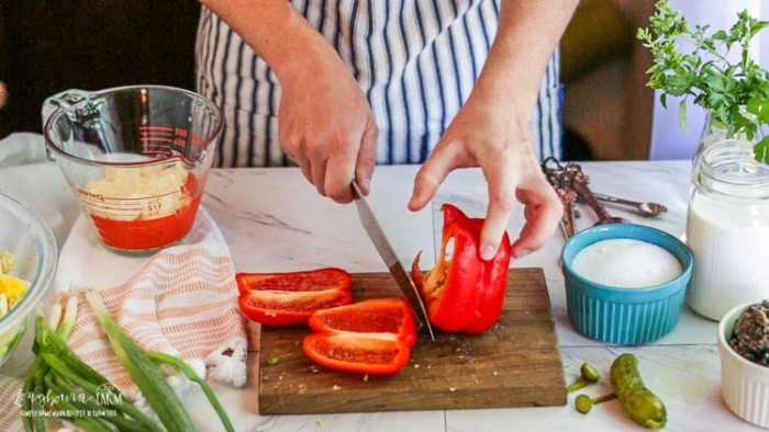 Slicing a red bell pepper.