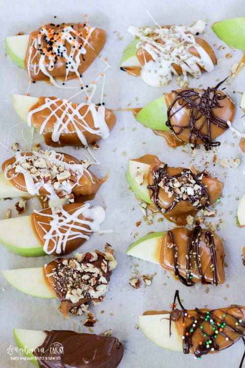 Far shot of easy caramel apples slices on a sheet tray.