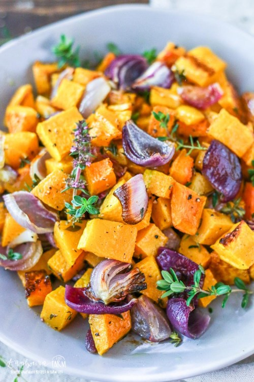 Close-up of baked butternut squash in a bowl.