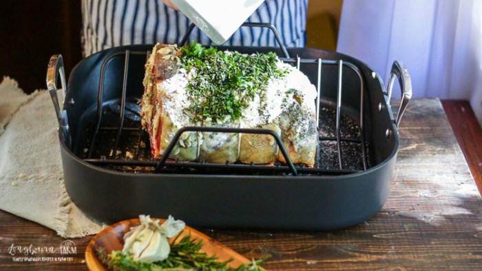 Seasoning the outside of the perfect prime rib roast.