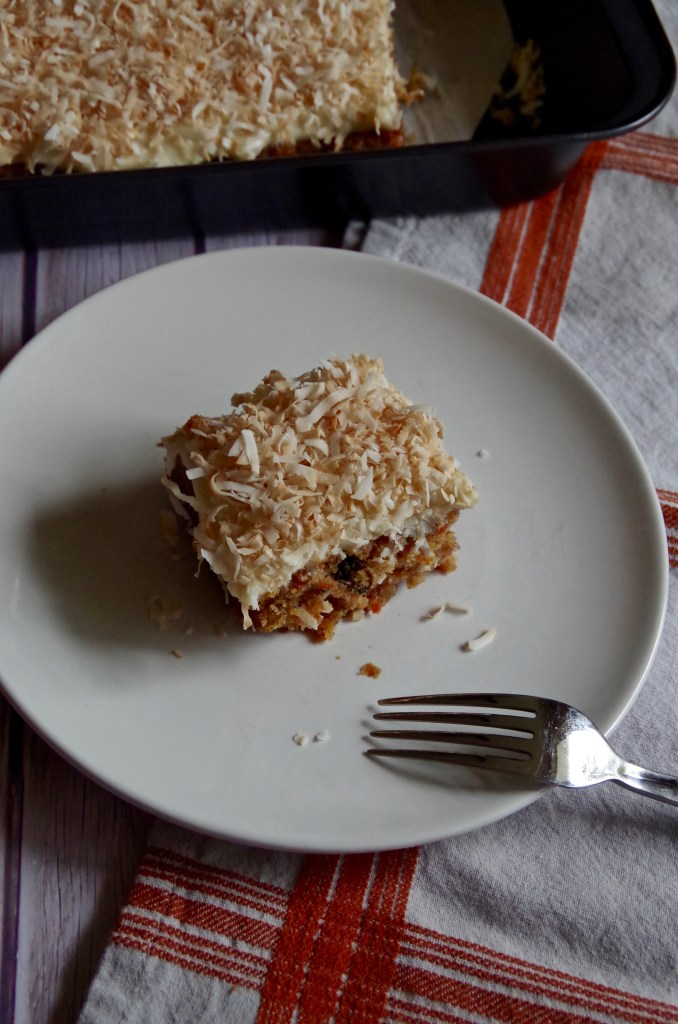 Rum Soaked Raisin Carrot Cake topped with Toasted Coconut - perfect for your Easter or Mother's Day Brunch! | longdistancebaking.com