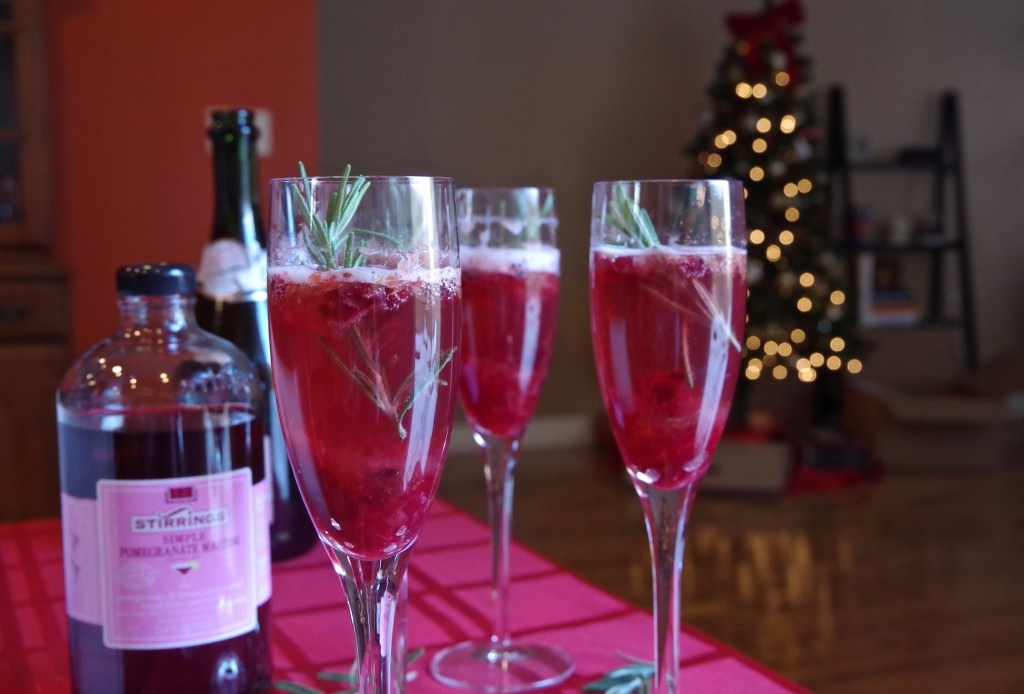 Cranberry Pomegranate Champagne Cocktail using Stirrings mixers. Perfect for New Year's Ever! | longdistancebaking.com