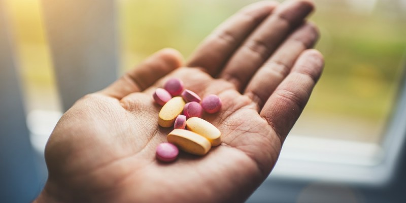 vitamin supplements in hand