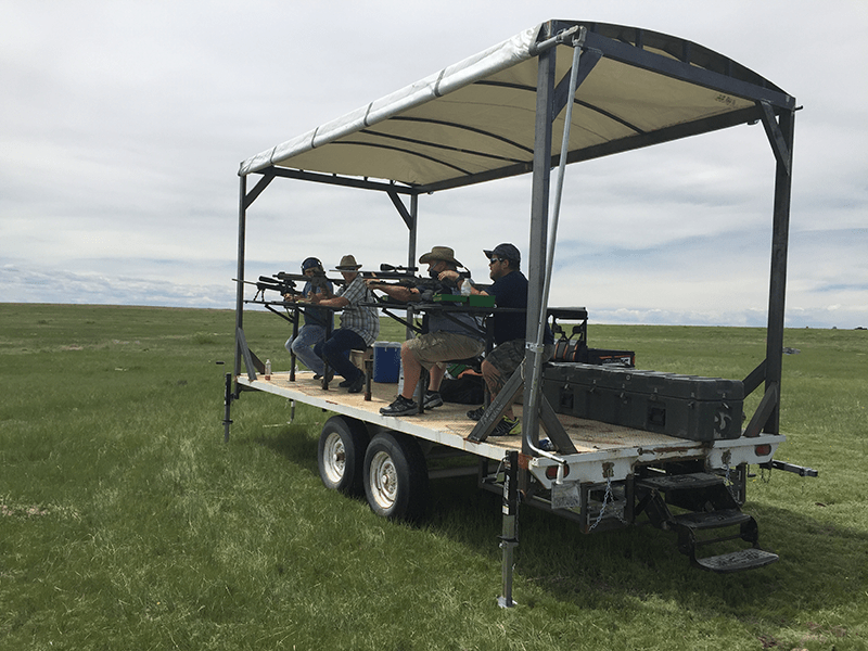 A group of guys shooting from the prairie dog trailer at Longmeadow Game Resort, Clays Club, And Event Center