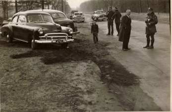 Officer Robitallie investigates an accident on Converse Street December 3rd, 1950