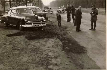 Officer Robitallie investigates an accident on Converse Street December 3rd, 1950