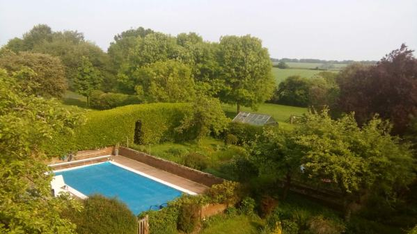 The swimming pool, viewed from the cinema room in our English luxurious country house sit