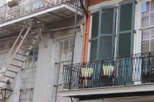 Beads on a railing, New Orleans, LA