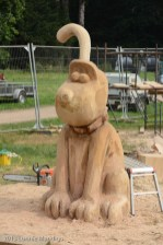 A partially complete chainsaw sculpture of Grommit.