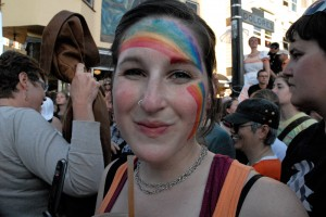 Rainbow-faced woman at Dyke March in San Francisco 2009