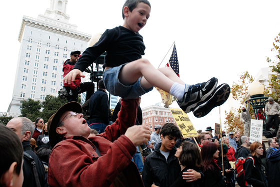 Money for School and Not War - kid tossed in air