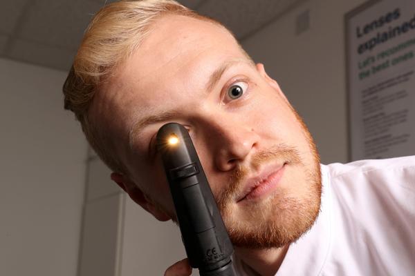 Optometrist conducting an eye examination