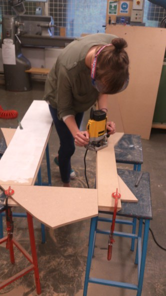 Straight cut legs using router after band saw.