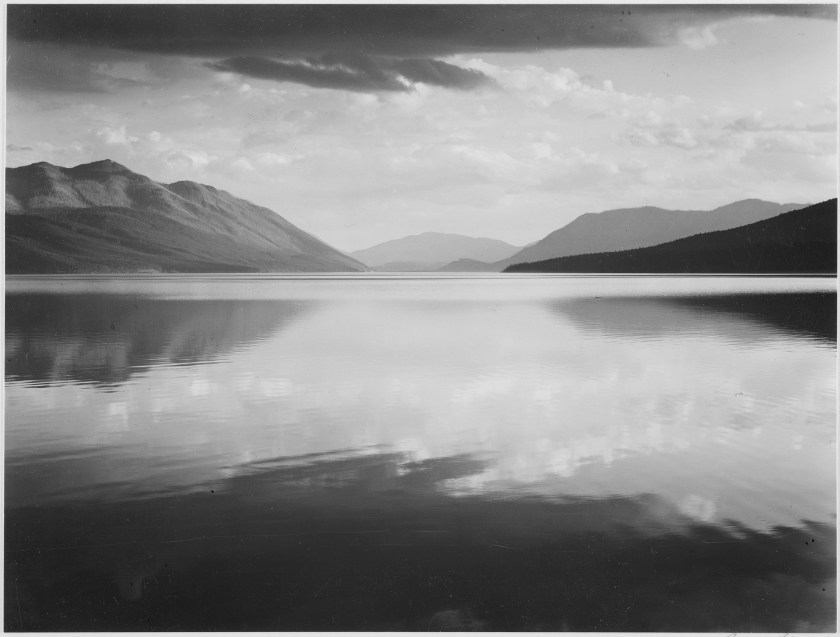 """Looking across lake toward mountains, ""Evening, McDonald Lake, Glacier National Park,"" Montana., 1933 - 1942 - NARA - 519861"" by Ansel Adams - U.S. National Archives and Records Administration."