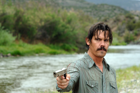 "Llewelyn (Josh Brolin) tries to ""stop what's comin'"" with a firearm. Bad idea."