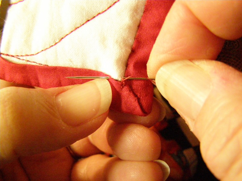 Tips and Tools Tuesday - Binding: Hand-Stitching the Back of a Mitered Corner