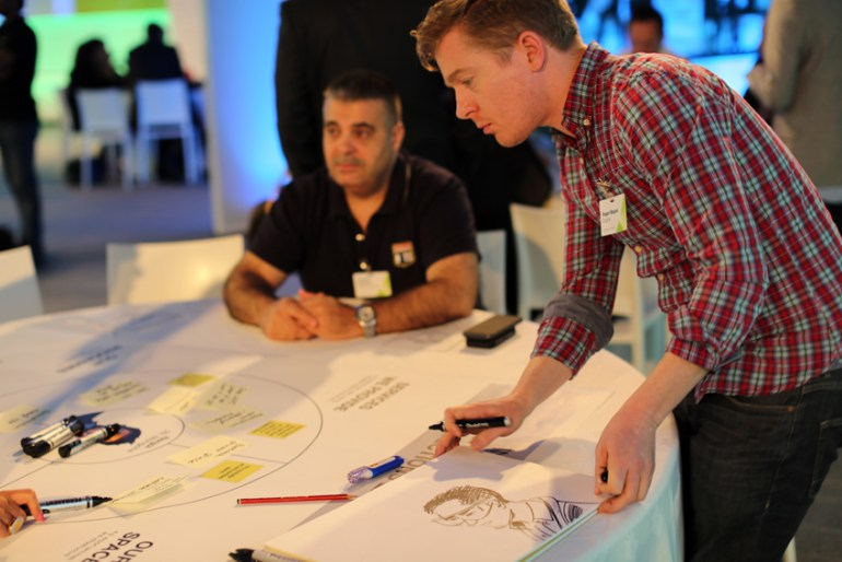 Roger Mason drawing at Dubai Airport's 'Dubai NX' event in 2014, with Engine Service Design.
