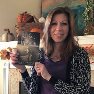 A Song of Home by Susie Finkbeiner (Pearl Allard holding book)