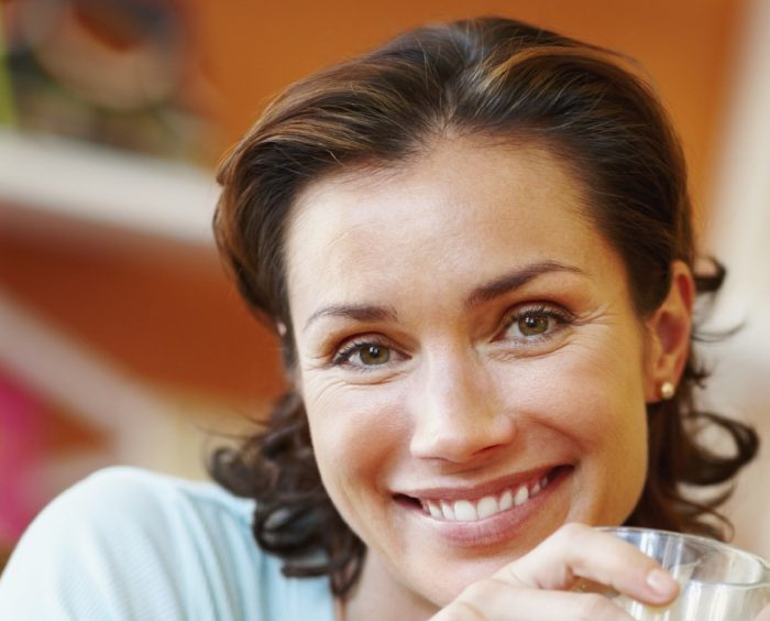 Portrait-Smiling middle aged woman in cafe (feature photo)