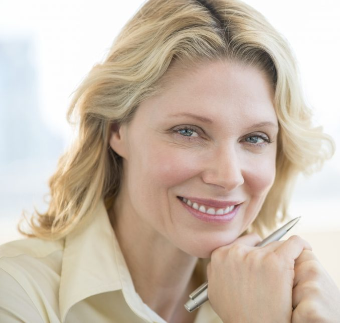 Pretty-blonde-mature-businesswoman-featured