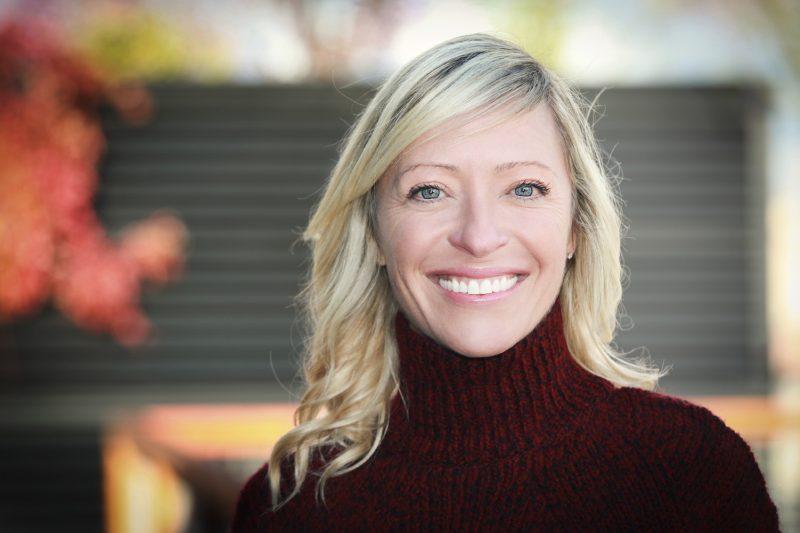 Smiling Blonde wearing Turtleneck