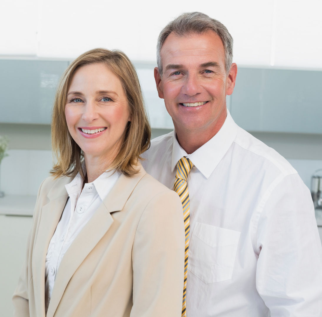Smiling professional couple – cropped