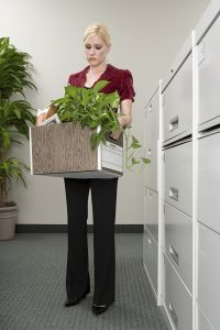 Woman with box of belongings