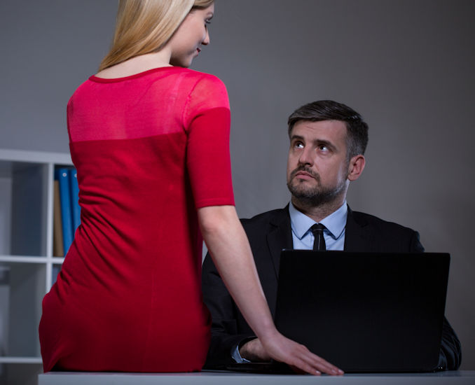 Sexual Harassment – Flirting Secretary iStock-481346570