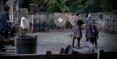 Screenshot from HBO's Game of Thrones: The boys shooting archery.