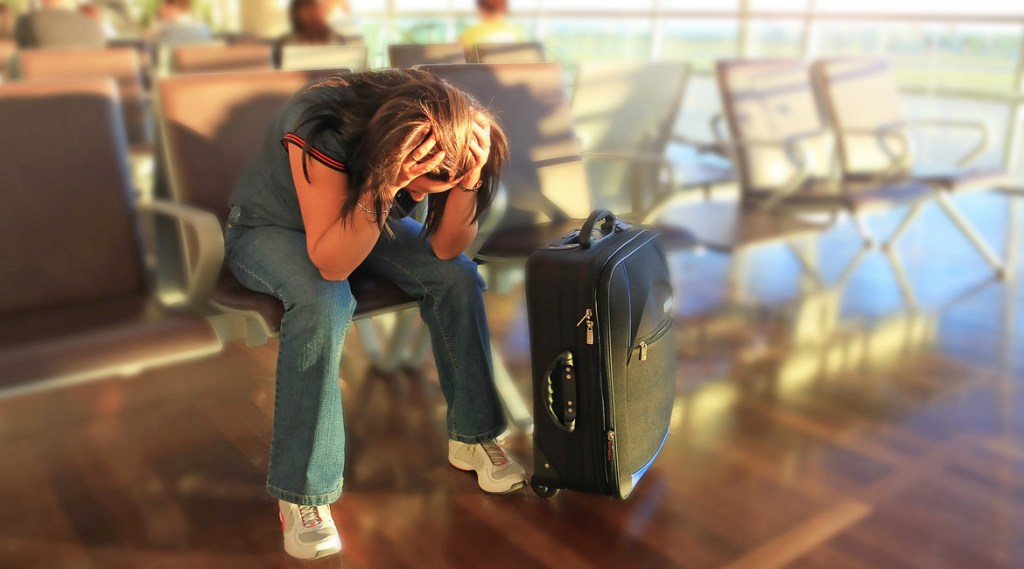 Depressed woman awaiting for plane with delay