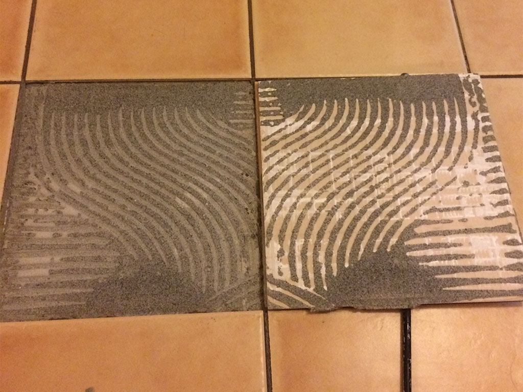 loose floor tile repair tile repair