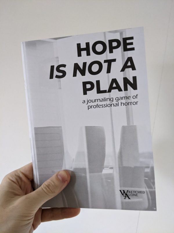"""A white A5 zine held against a plain white background. The cover has faded grey shapes that resemble office chairs or skyscrapers. The title reads """"Hope Is Not A Plan: a journaling game of professional horror""""a"""