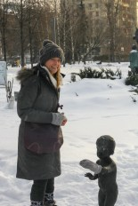 Caitlin putting her mitten on the little statue. She thought it was hilarious, and laughed just as hard when I showed her the picture.