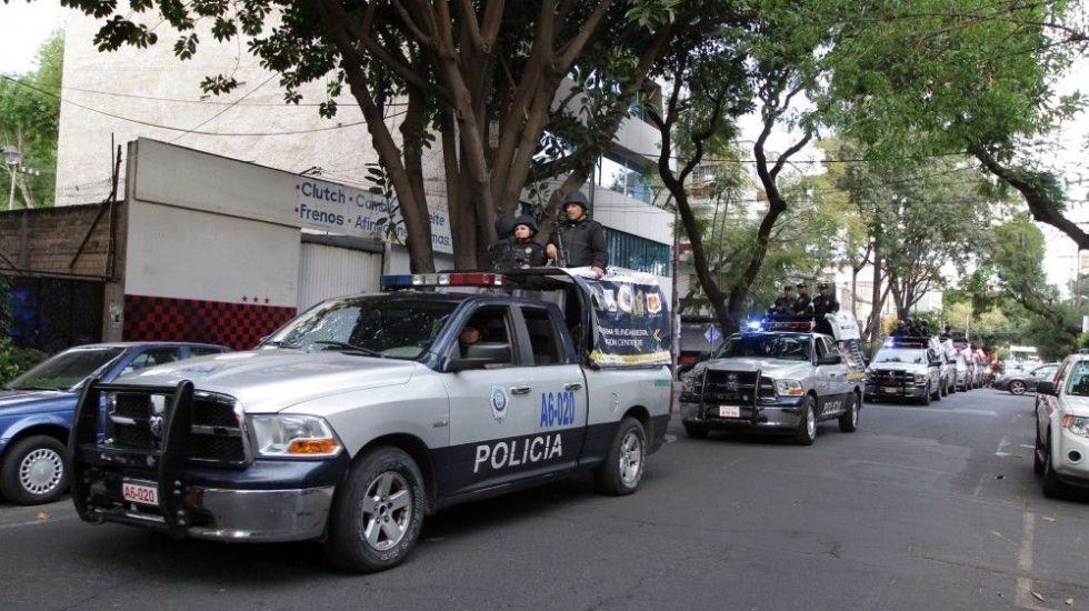 Recuperan tres camiones robados con ropa de caballero en Venustiano Carranza - Foto de archivo