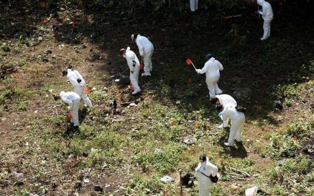 Laboratorio de Austria certificará si restos calcinados son de normalistas - Reforma
