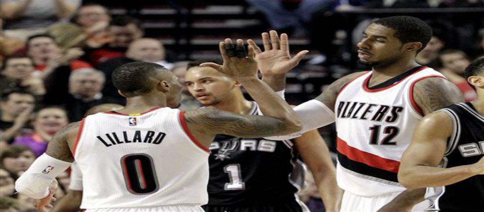 Blazers ganan a unos Spurs mermados - Foto de AP