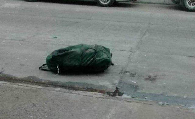 Hallan restos humanos en una maleta en Apatzingán - Foto: Quadratín.